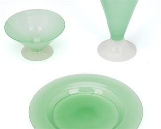 """235 A Set Of Steuben Jade And Alabaster Glass Dishes Second-quarter 20th Century; Corning, New York Each signed: Steuben Each of jade glass, comprising six plates (.5"""" H x 8.5"""" Dia.), six flared sherbet glasses on alabaster feet (2.5"""" H x 5"""" Dia.), and six flared lemonade glasses on alabaster feet (6.5"""" H x 4.25"""" Dia.), 18 pieces Estimate: $800 - $1,200"""