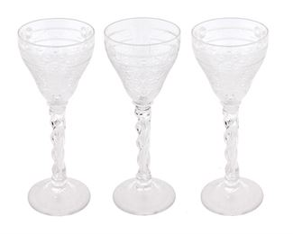 """237 A Set Of Webb Corbett Cut Crystal Wine Goblets Circa 1930-1947 Each signed: Webb Corbett / Made in England Each wine goblet with cut foliate and floral motifs and frosted scrolling band raised on a twisted stem, 16 pieces Each: 10"""" H x 3.75"""" Dia. Estimate: $1,000 - $1,500"""