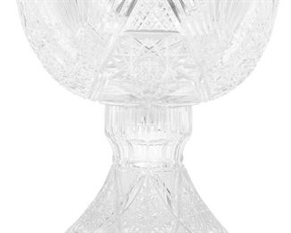 """239 An American Brilliant Cut Glass Punch Bowl With Stand Late 19th/early 20th Century The Brilliant cut glass punch bowl and stand with hobstar and fan motif, fine crosshatching, and sawtooth scalloped edges, 2 pieces Overall: 13.25"""" H x 12.25"""" Dia. Estimate: $1,000 - $1,500"""