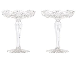 """241 A Pair Of American Brilliant Cut Glass Compotes Late 19th/early 20th Century Each Brilliant cut glass compote with hobstar and fan motif, fine crosshatching, sawtooth scalloped edge, and a teardrop stem raised on a scalloped circular foot, 2 pieces Each: 9.5"""" H x 7.75"""" Dia. Estimate: $800 - $1,200"""