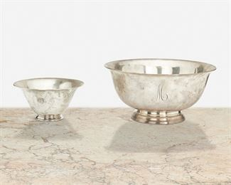 """244 Two American Paul Revere-Style Sterling Silver Bowls Circa 1925-1932 One marked: Tiffany & Co. / 20785 / Makers / 4070 / Sterling Silver / 925-1000 / M [John C. Moore II]; One marked: S. Kirk & Son, Inc. / Sterling / 221 Each Paul Revere-style bowl raised on pedestal foot with flared body and personalized, 2 pieces Larger: 4.75"""" H x 9.5"""" Dia.; Smaller: 3"""" H x 6"""" Dia. 41.11 oz. troy approximately Estimate: $500 - $700"""