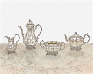 """247 An English Sterling Silver Coffee And Tea Service Circa 1853; London, England Marked for sterling Each pumpkin-form raised on foliate feet and engraved with Tudor rose and stag antler emblems, comprising a coffee pot (11"""" H x 8.5"""" W x 5.5"""" D), a teapot (6.5"""" H x 10"""" W x 6"""" D), a creamer (6.25"""" H x 5"""" W x 3.5"""" D), and a sugar bowl (4.25"""" H x 8.25"""" W x 5.75"""" D), 4 pieces 69.81 oz. troy approximately Estimate: $800 - $1,200"""