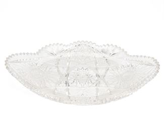 """250 An American Brilliant Cut Glass Ice Cream Dish Late 19th/early 20th Century Signed: Libbey The oval Brilliant cut glass ice cream dish with hobstar and fan motif and sawtooth scalloped edges 2.75"""" H x 17.5"""" W x 10.25"""" D Estimate: $800 - $1,200"""