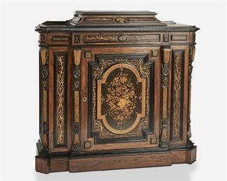 """259 An American Renaissance Revival Console Cabinet Third-quarter 19th Century The breakfront-style Renaissance Revival console cabinet with ebonized wood accents, incised gilt highlights, geometric parquetry to the sides, and pedestal top over a single frieze drawer with lockplate, a door with floral inlay to front panel and lockplate, and fitted interior with a single shelf 45"""" H x 49"""" W x 16.5"""" D Estimate: $1,500 - $2,000"""