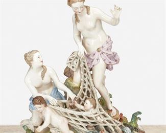 """263 A Meissen """"Capturing The Tritons"""" Figural Group Late 19th/early 20th Century; Germany Marked for Meissen [Blue Crossed Swords underglaze]; Further marked: C 35 / 57 Originally designed by Kandler, Punct, and Schonheit, the porcelain mythological figural group depicting an infant Triton caught in a fishnet being pulled by two nymphs and a putto on a rocky ground 12.5"""" H x 10"""" W x 7"""" D Estimate: $800 - $1,200"""