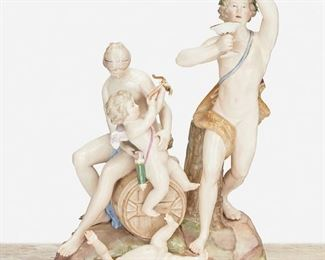 """264 A Meissen """"Bacchus"""" Figural Group Late 19th/early 20th Century; Germany Marked for Meissen [Blue Crossed Swords underglaze]; Further marked: B 19 Depicting Bacchus and Cupid with putti and female attendant sitting atop a wine cask 12.5"""" H x 9"""" W x 8"""" D Estimate: $800 - $1,200"""