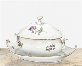 """268 A Meissen Lidded Tureen And Underplate Late 19th/early 20th Century; Germany Each marked for Meissen [Blue Crossed Swords underglaze]; Further marked: 671 1 / 16 Each white porcelain with polychrome floral sprays and gilt highlights, comprising an ovoid bombe-form tureen with opposed foliate handles, domed lid with twisted finial, and prominent orange nasturtiums and purple daisies and an ovoid underplate with scalloped edge and upturned handles, 2 pieces Tureen: 10.5"""" H x 15"""" W x 9.5"""" D; Underplate: 4"""" H x 19.5"""" W x 13.5"""" D Estimate: $600 - $800"""