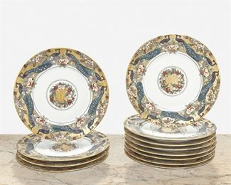 """269 Twelve """"Della Robia"""" Hand-Painted Porcelain Plates 1908-1909 Each dated and signed: EL Each banded with Della Robia-style peacock and fruit swag motif on a gilt ground with matching central medallion, 12 pieces Each: 1"""" H x 10.5"""" Dia. Estimate: $600 - $800"""