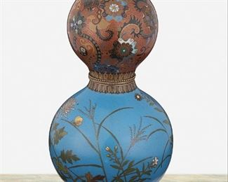 """280 A Chinese Double-Gourd Cloisonné Vase Second-quarter 20th Century The detachable double-gourd cloisonne vase with polychrome scrolling foliate motif against a brick-red ground to the top and polychrome floral and butterfly motifs against a blue ground to the bottom with gilt-metal beaded band to the center 9"""" H x 5"""" Dia. Estimate: $500 - $700"""