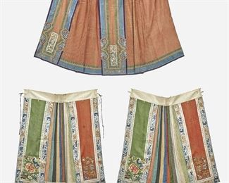 """284 Two Chinese Embroidered Silk Apron Skirts Late Qing Period (1644-1912) One with stamped label Each apron skirt with multicolored silk panels and accordion pleats, comprising one with floral applique and one with figural scene, 2 pieces Larger: 39"""" L x 45"""" W; Smaller: 37"""" L x 44"""" W Estimate: $800 - $1,200"""