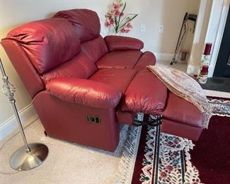 Leather reclining loveseat.