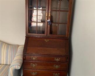 #6Wood Drop-Front Secretary w/3 drawers & 2 glass doors w/2 shelves  30x17-28x71   (has cubbies inside the drop front) $175.00