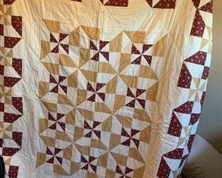 #57Reversible pinwheel Burgandy/Cream - machine quilted $65.00
