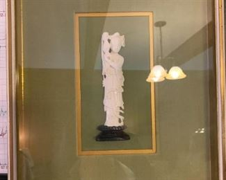 #171Soapstone statue in a frame $34.00