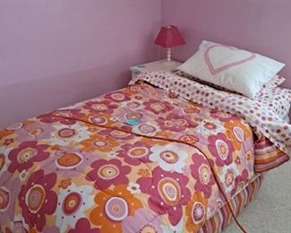 Pair of Twin Bed Frames and Foundation; the pink, white, orange bedding will be sold as well.