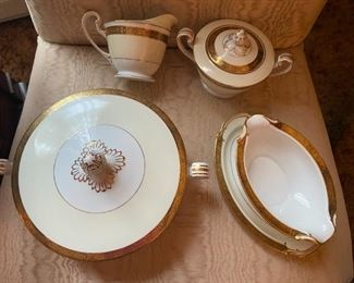 """Part of the set of Noritake china in the """"gold Kin"""" pattern."""