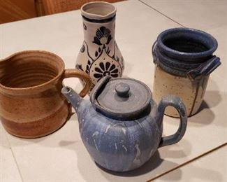 Item #5a-d: $15ea, teapot $22. Choice of pottery.  A. Brown pitcher B. White/blue vase C. White/blue crock D. Blue Tea pot