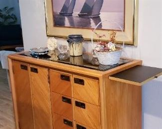 """Item #1: $250. Stanley brand sideboard. Both sides pull out for extra space. Smoky glass mirror top. Good condition. 42 L"""" x 35 H"""" x 18 D"""""""
