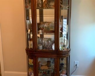 Display Cabinet.  Lighted.  Mirror Back.  Adjustable glass shelves.  Can be separated to 2  units.  $200