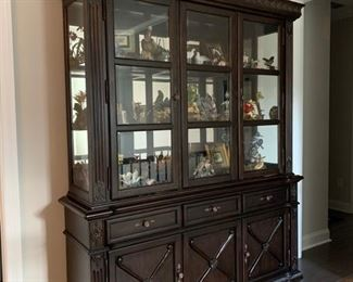 """Dark Walnut Dining Buffet & China Hutch (Ashley Furniture).  China Top: 2 glass shelves for display; lighted case; mirrored back; Buffet bottom has 3 lined cloth drawers for flatware & under-cabinet storage.  Dimensions: Buffet Length: 71"""" x 18.5"""" deep x 36"""" high; China Top: 66"""" length x 18.5"""" deep x 52"""" high; Interior Shelf 13.5"""" deep.  $800"""