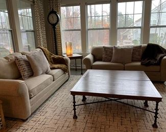 2 custom upholstered sofas with walnut finish; cappella rug