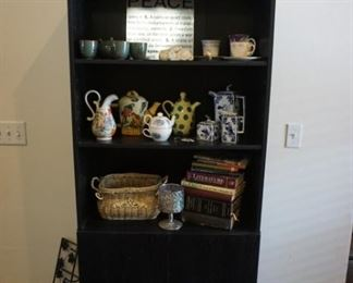 bookcase, tea pots, cups and saucers, tea sets