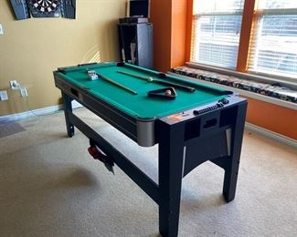 This Mini Pool Table / Game Table is perfect for a den or Man Cave. Excellent condition and ready for action!