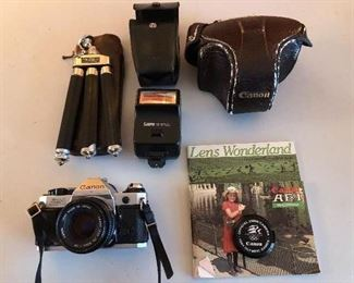 Canon AE -1 program. Made in Germany tripod. 1984 Olympic lens cover.