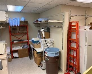 We have shelving, cleaning products, a fridge, supplies, a towel warmer/sterilizer, ladders, hangers, tissue.....