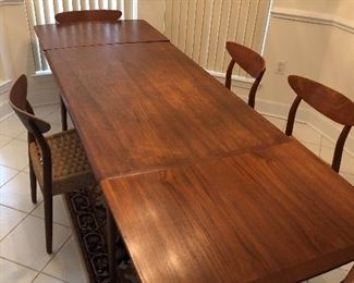 """PRE SALE ITEM  - BEAUTIFUL Mobler style teak draw leaf dining room table -  fully extended 99 ¾"""" long and closed 56"""" long.   33 ¼"""" wide.  Stamped Made in Denmark - $1695 with 5 chairs included."""