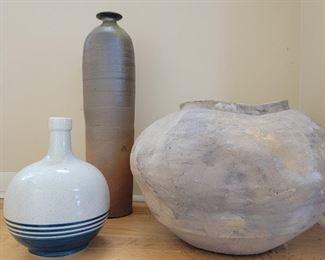 "tall vase 19""h, large on right 14"" diameter"