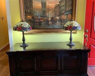 dark wood TV stand with storage, large framed art