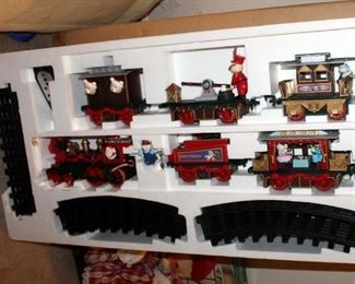 Christmas Magic Battery Operated Train With 5 Cars, Track, And Remote, Ceramic Snowman Platter, Wood Santa Bench, And More