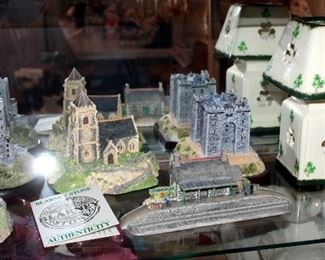 Irish Heritage Collectible Buildings Qty 7, St. Patrick Figure And Porcelain Shamrock Candle Votive, Contents Of Shelf
