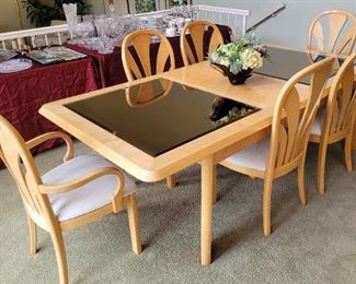 Contemporary dining table....birds eye maple wood