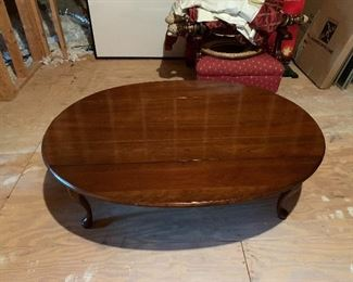 """$100.00 Harden Queen Anne.  Drop Leaf Coffee Table....Oval When Opened and Rectangular when Leaves are Down. Minor Surface Damage...See Next Picture...51 w x 22 d x 17 h....39"""" when open."""