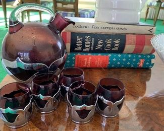 Vintage Kitchen Items - includes cookbooks, milk glass compote, pottery pitcher and a vintage pitcher/glass set from Farber brothers in a deep shade of purple.