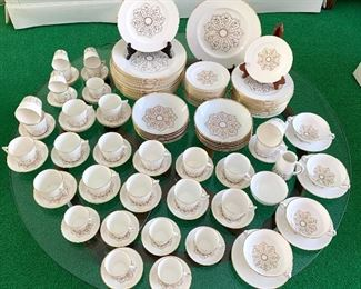 Royal Crown Derby China Dish Set   16 dinner plates 12 soup bowls 16 salad plates 16 bread plates 4 creams with under plates 21 tea cups/saucers 13 demitasse cups/saucers Cream/sugar No noticed chips or cracks.One teacup has some slight crazing.