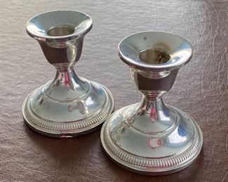 """Sterling Candle Holders - lovely weighed sterling candle holders by Fisher- (marked Fisher 830 on the bottom) Measures 3.5"""" H. One has a slight dent on the bottom/side."""