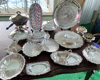 17 Pieces of Vintage Silver Plate Serving Items. Includes a divided dish, covered dishes, chaffing dish, trays and more