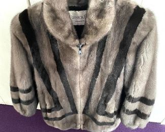 Ladies Fur Coat w/ Unique Design - Quality crafted coat from Ribnick Furs. Comes with a pair of earmuffs.  This jacket has two front pockets and a quality interior lining that is stitched inside with the previous owner's name. No size label, however; likely a size small.