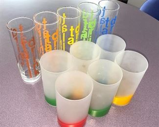 """Super fun bar glasses! Five 7"""" tumblers that have rainbow colored graphics that say, """"Tall Drink"""" and six frosted tumblers with rainbow colored bottoms measuring 5.25"""" tall"""