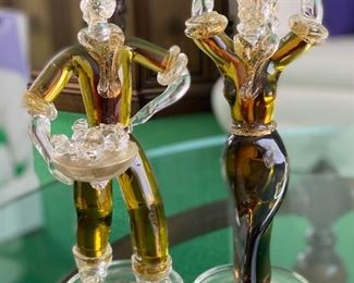 """What a fun pair of hand crafted art glass figurines. Likely Venetian art glass?  No noticed chips or cracks. The female figurine measures 13"""" and the male figurine at 12"""" tall"""