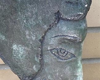 """Face; Figural Sculpture - possibly made of stone?  One small chip on the top. Measures 13"""" H and the base is 8"""" x 3"""""""