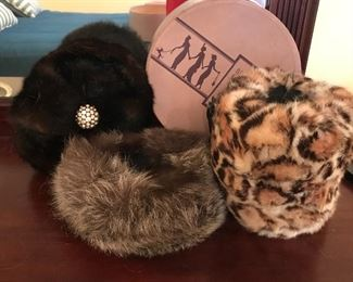 Assorted fur hats and muff