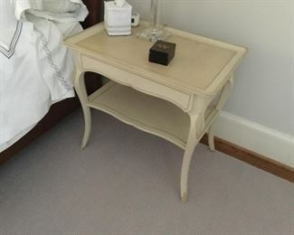One of a pair of bedside tables