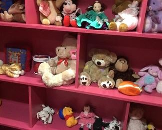 Lots of dolls and stuffed animals
