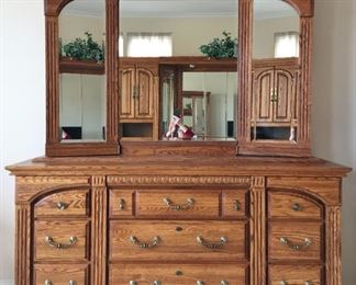 """Georgian Court dresser with mirror 78.5"""" high, 70"""" wide, 19.75"""" deep. Mirror doors open to jewelry storage on one side, shelves on other side."""