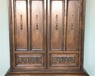"""Armoire/chest of drawers Arched top, double doors open to 4 drawers and shelf storage, two large lower drawers. 74.5"""" high, 39"""" wide, 19.5"""" deep."""