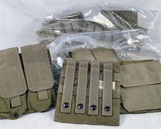 Mfg - (20) Eagle Industries Model - M4 double Mag panel Qty - 20 Condition - 1 - New This lot contains 20 M4 double mag panels. Each panel has the capacity to hold 4 (30) round AR magazines in a nice army green color